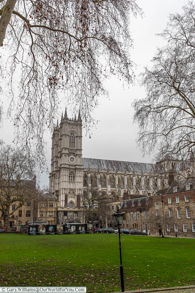 Looking across the lawn of Dean's Yard with Westminster Abbey in the background.
