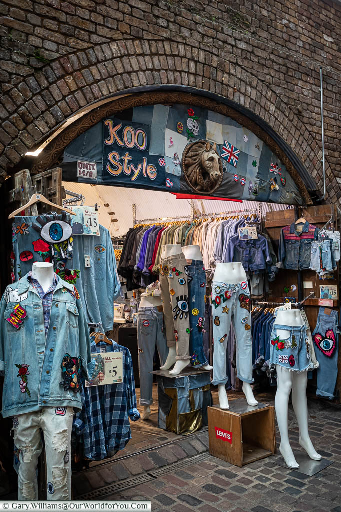 The Koo style store in one of the railway arches in Camden Market.  The focus on the street display is denim, in some cases, double denim.