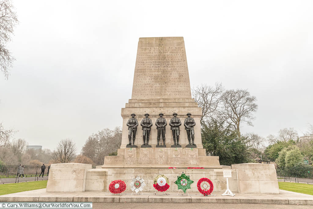 A portland stone memorial, with five statues of near-identical soldiers,  to those of the Guards Division who lost their lives in World War One.