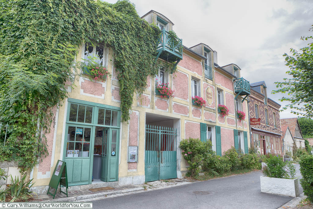 The very picturesque Hotel Baudy decorated with window boxes in the quaint town of Giverny