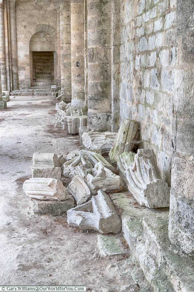 Fallen pieces of masonry from the ruins of the Jumieges Abbey in Normandy collected together.