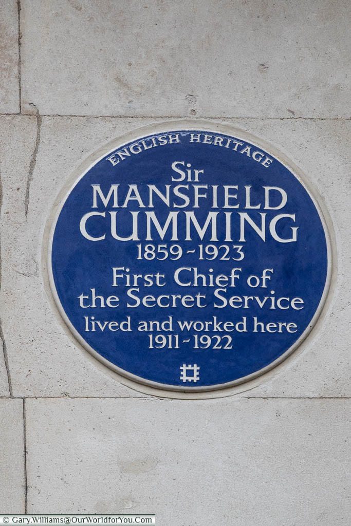 The English Heritage blue plaque to Sir Mansfield Cumming, the first Chief of the Secret Service who live and worked in at 2 Whitehall Court, Westminster between 1911-1922.