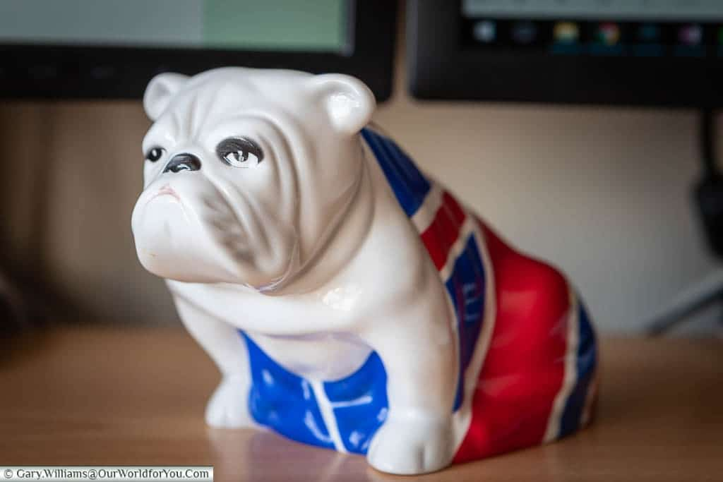 A Royal Doulton china Bulldog, in a seated postion, wearing a Union Jack 'coat' on my desk at home.  This is the same piece that features in the James Bond movie 'Skyfall'.