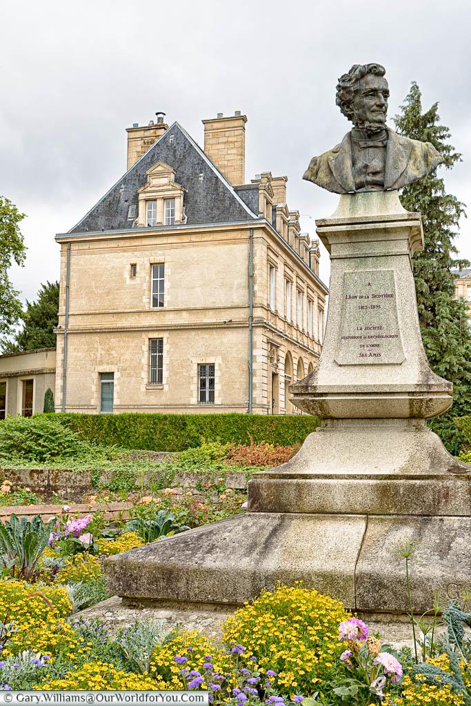 A stone bust of Léon de La Sicotière in a garden in the centre of Alençon, Normandy