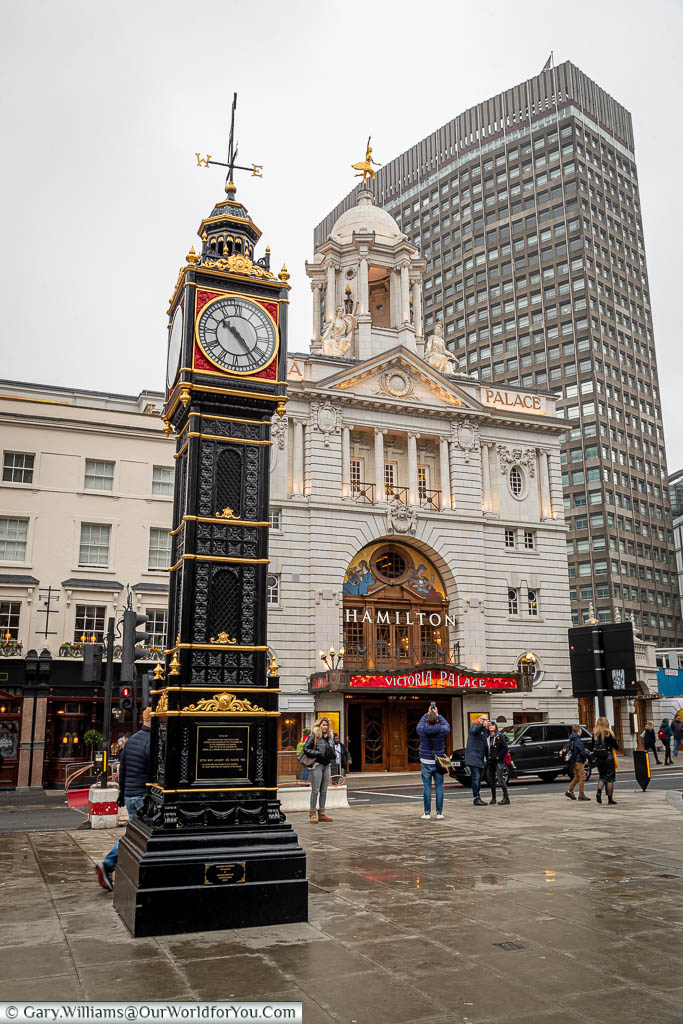 The black and gold cast-iron clock tower known as 'Little Ben' in front of the Victoria Palace Theatre in London's Victoria.