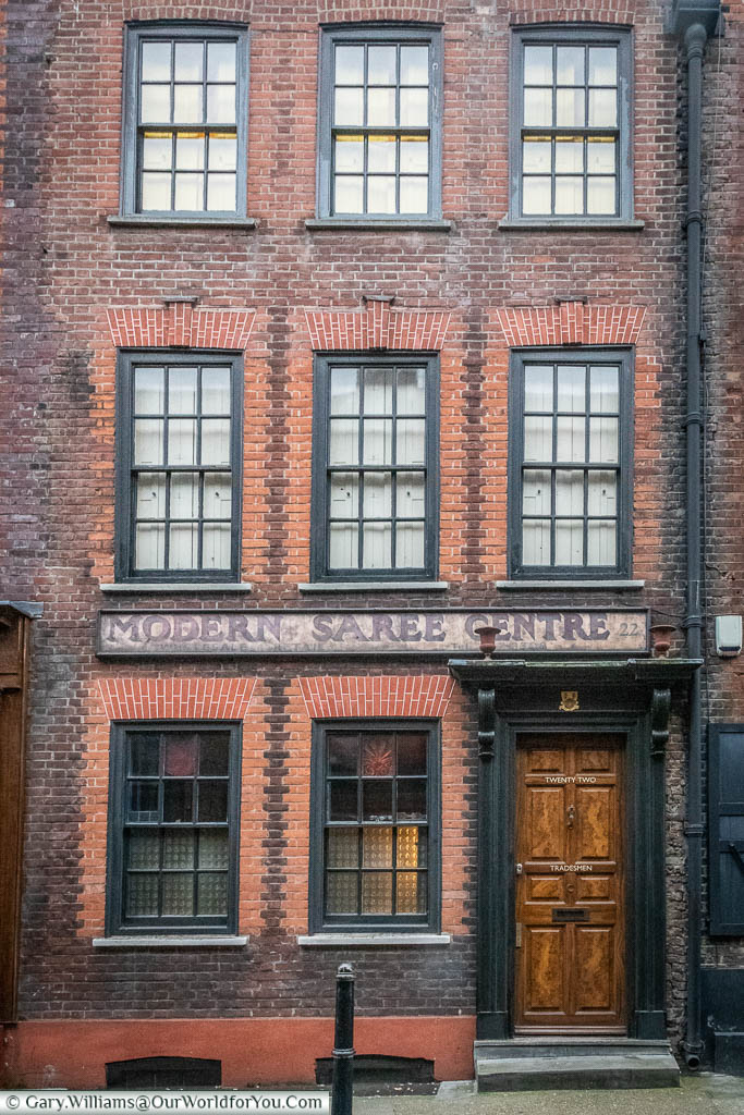 A beautiful brick building in Princelet Street, Spitalfields, that is now home to the Modern Saree Centre.
