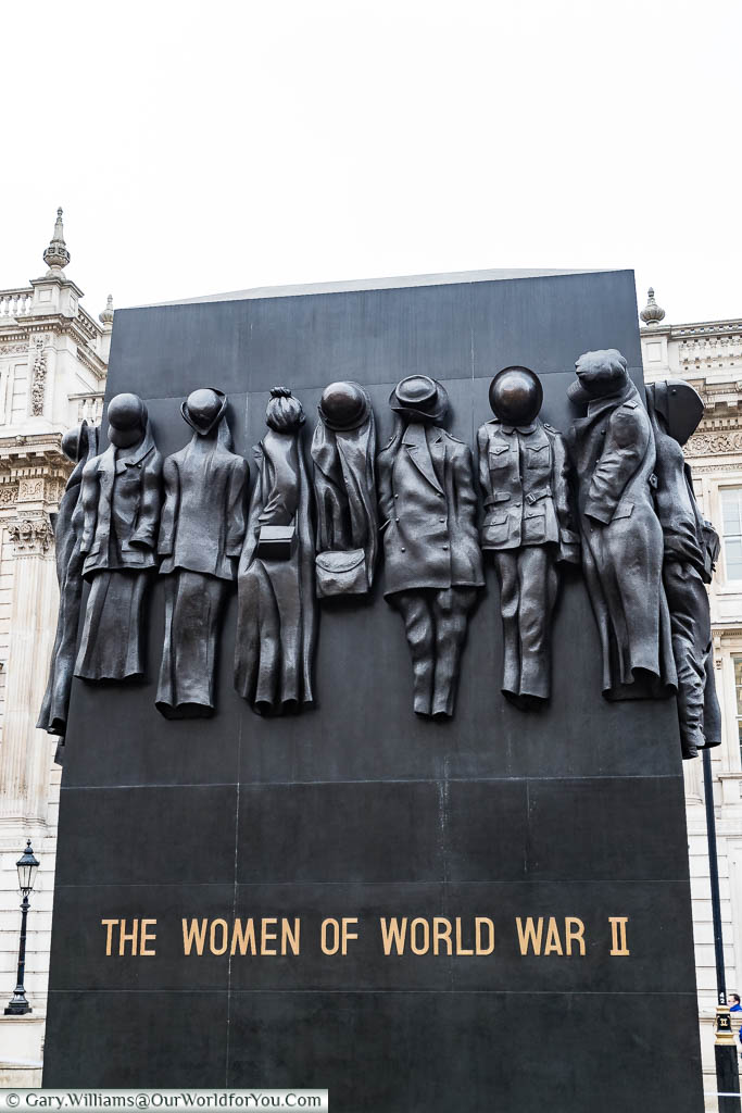 Monument to the Women of World War Two in Whitehall.  The black monolith features various uniforms hanging that represent the different roles women played in the Second World War,