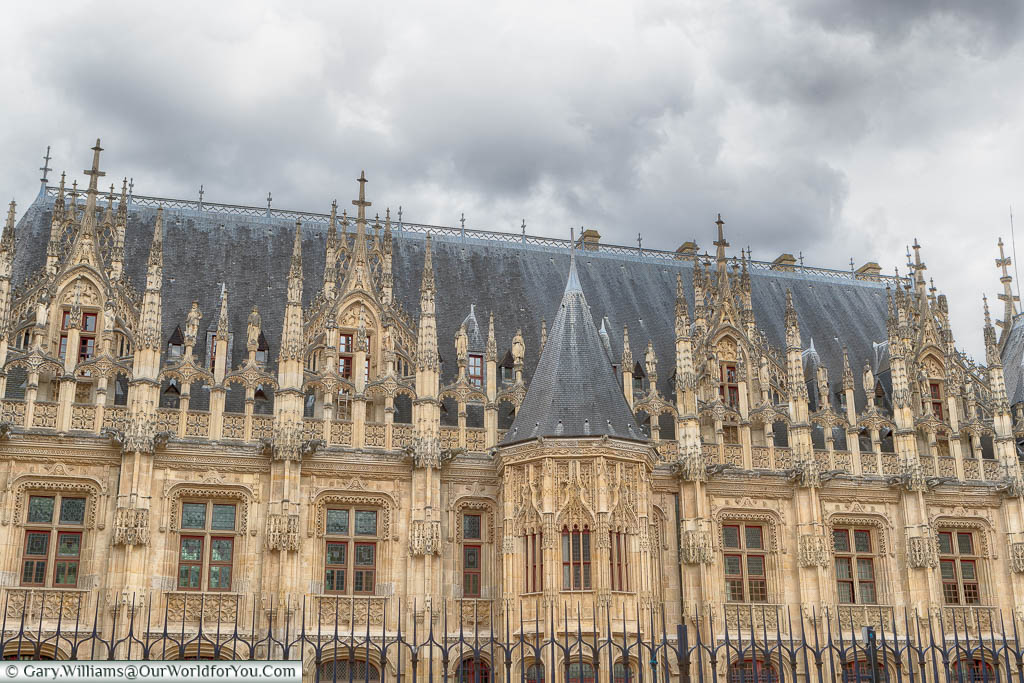 The beautiful gothic detail in the Palais de Justice in the centre of Rouen.  The golden stone still seems bright under grey skies.