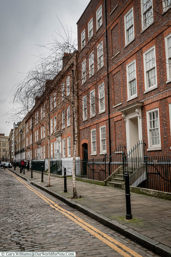 The cobbled Folgate Street with its elegant Georgian buildings in the Spitalfield district.