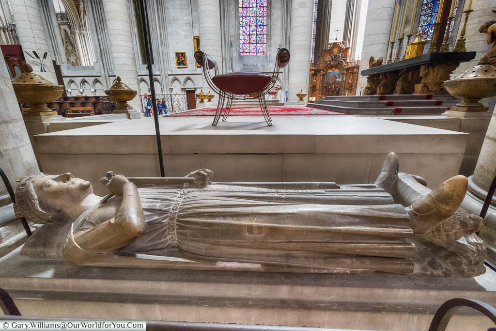 The tomb of Richard the Lionheart inside of Rouen Cathedral in Normandy. The stone tomb topped by a supine figure of the King wearing a crown and holding his sword by his side.