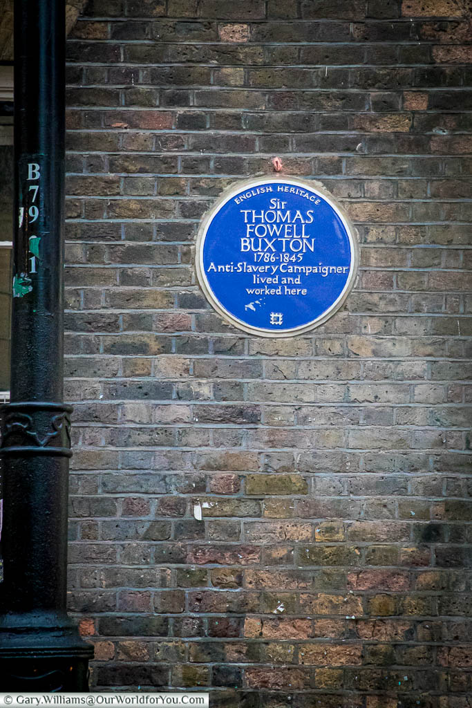 A blue plaque, issued by English heritage, to Sir Thomas Fowell Buxton, Anti-Slavery campaigner along Brick Lane.