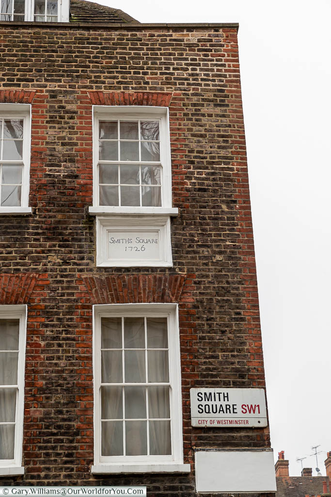 The corner of Smith Square, showing the original street sign from 1726, in addition to a more modern one.