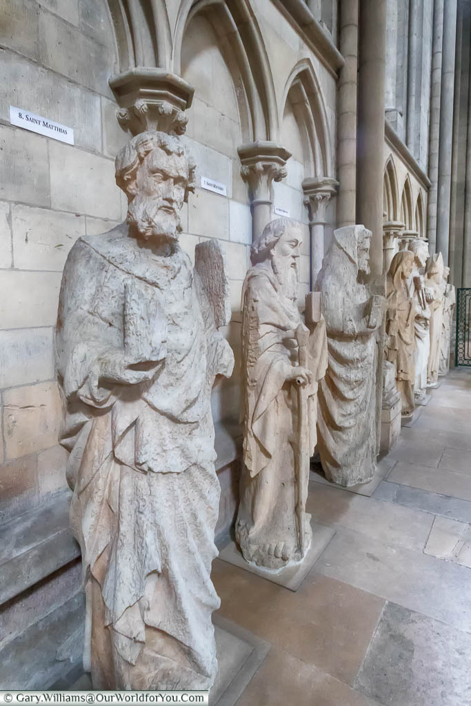 Stone statues of religious figures lined up on the inside of Rouen Cathedral in the heart of Normandy.