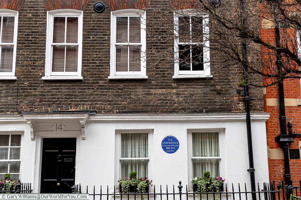 A blue plaque on number 14 Cowley Street, Westminster, once home to T.E. Lawrence  who is probably better know as Lawrence of Arabia.