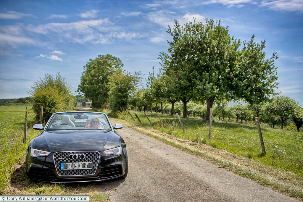 Our car, an Audi Convertable, parked next to the apple orchards in Normandy.