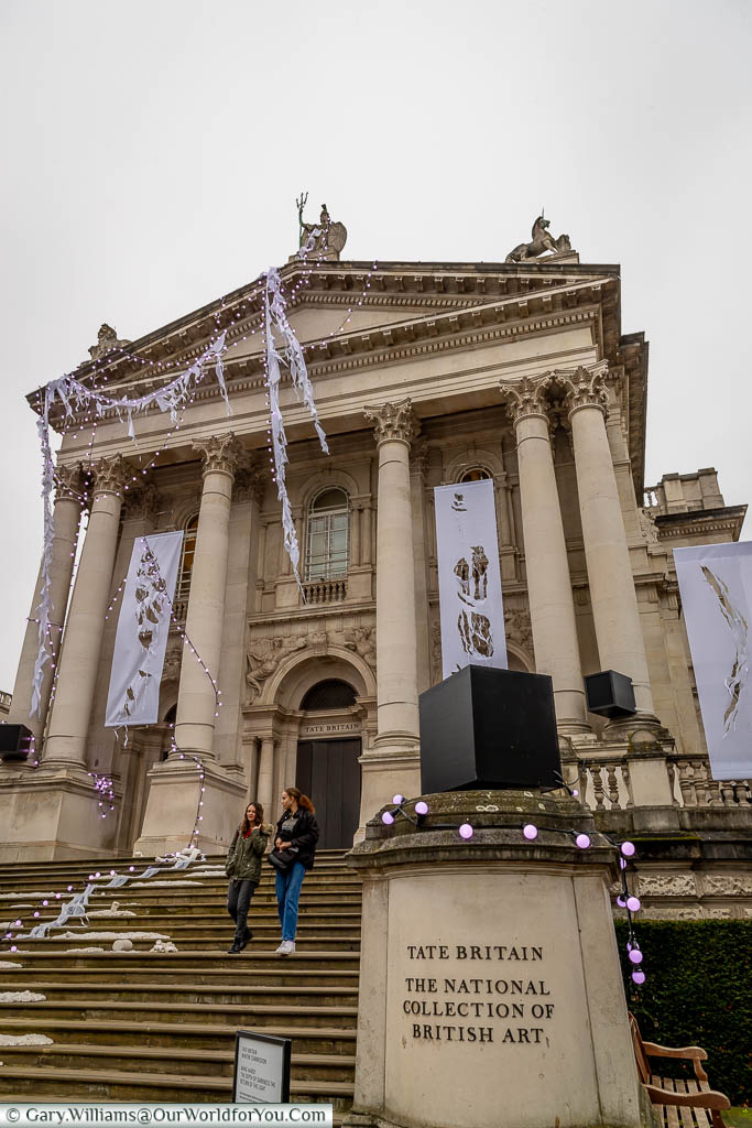 You are looking up to the neo-Classico portico of the Tate Britain gallery on the banks of the River Thames.