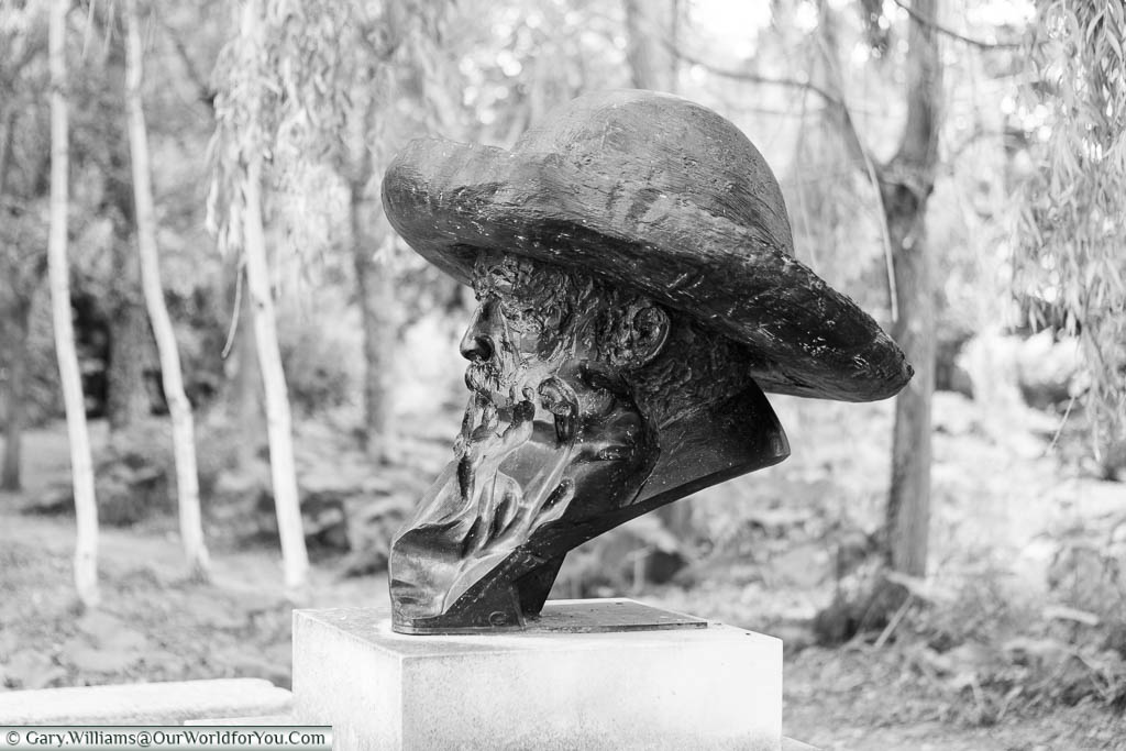 A black and white profile shot of a bust of Claude Monet that stands in the gardens of Giverny, Normandy