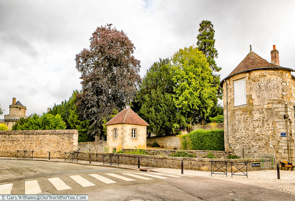 The ramparts and stone wall that would have once marked the edge of old Alençon, Normandy.
