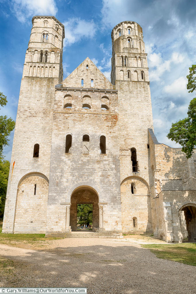 The golden stone of the entrance to the ruins of the Jumieges Abbey in Normandy