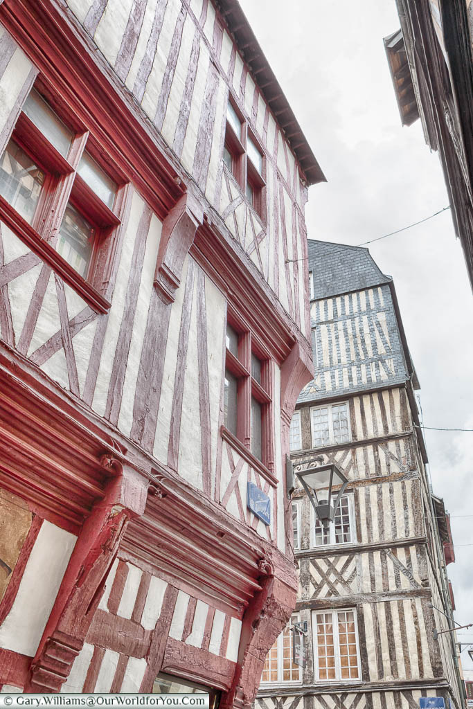 A close-up look of two of the traditional buildings in the centre of Rouen featuring half-timbered constructions that is so typical of the Normandy region of France