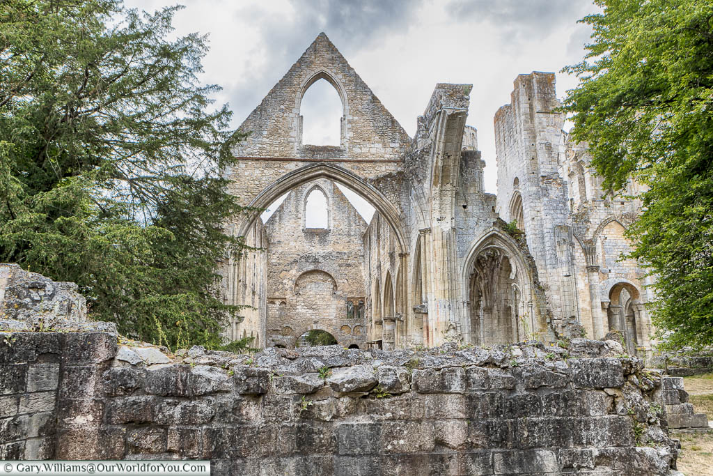 The massive stonework of Jumieges Abbey still defines the outlines of the chapels.  In the background is the former gothic masterpiece.