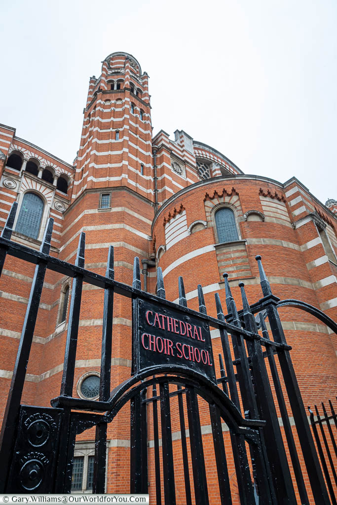 The gate to the Cathedral Choir School, with the bell tower of Westminster Cathedral in the background.