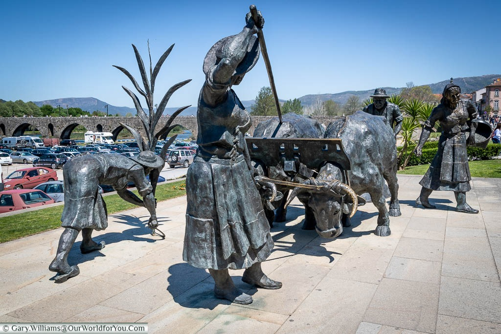 A series of Bronze statues depicting Portugues farmworkers with their tools and beasts of burden in Ponte de Lima, Portugal