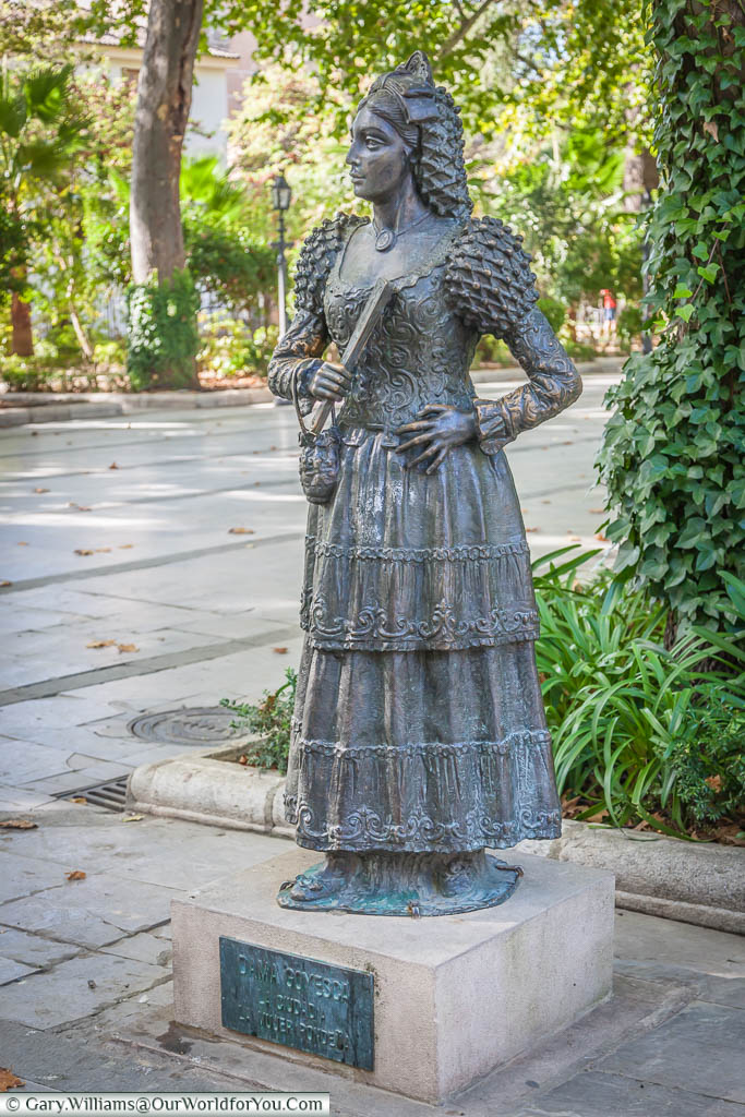 A statue to the Dames Goyesca, in traditional dress outside the bullring in  Ronda, Spain.  The ladies of Ronda have been the official representatives of the city since the 1950s