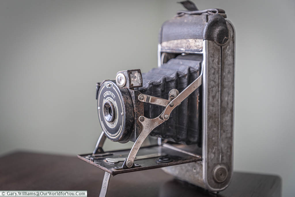 A side profile of the well-worn Coronet camera, with its bellows extended, a cheap but robust companion.