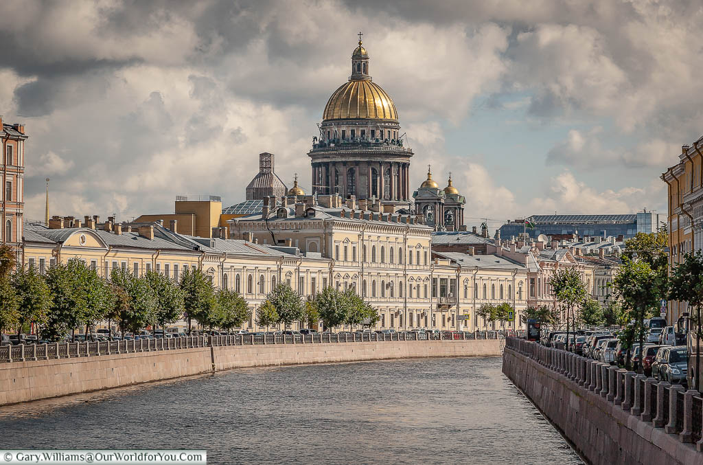 The dome of Saint Isaac's church dominates the skyline over the Moyka River, St Petersburg, Russia St Petersburg, Russia