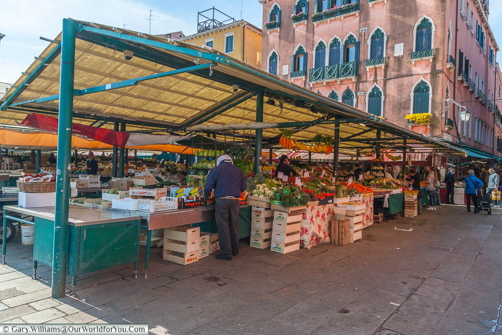 A fruit and vegetable stall at the Mercato di Rialto, Venice, Italy