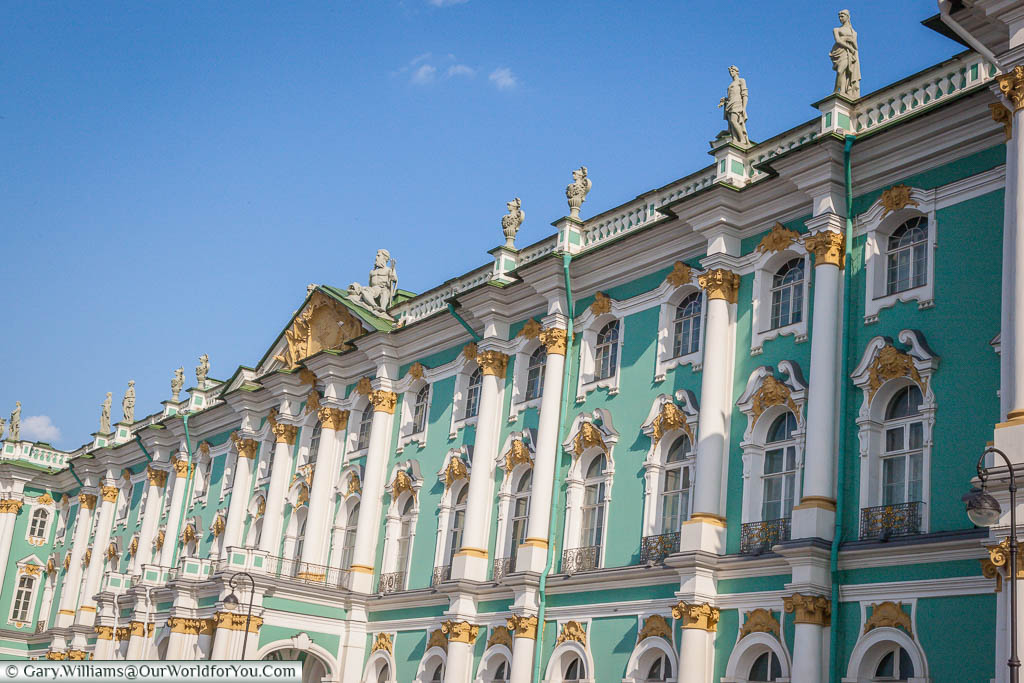 The green and white with mustard yellow trimmings exterior of the Hermitage Museum in Saint Petersburg, Russia