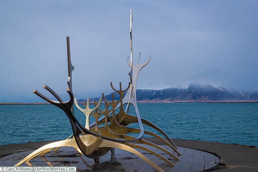 A conceptual stainless steel sculpture of a Viking boat on the water's edge in Reykjavik, Iceland.