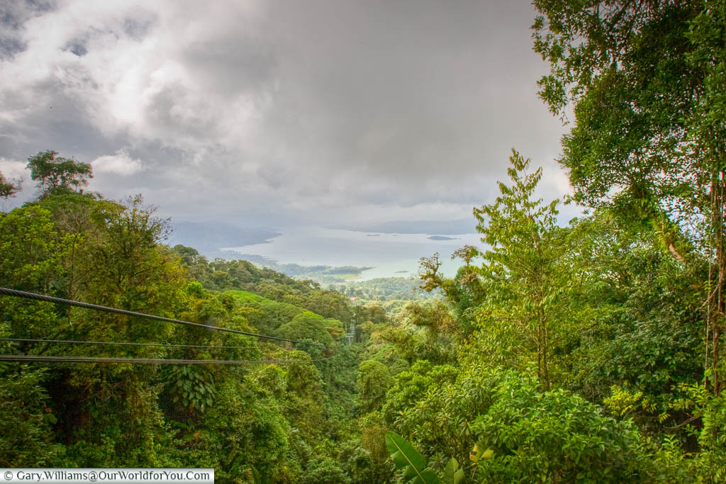 A cable car line trails through the lush, green, vegetation towards Lake Arenal in this stunning part of Costa Rica.