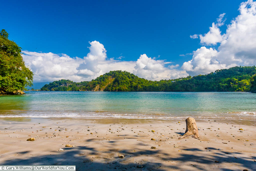A sandy beach, Playa Biesanz, in a bay in Manuel Antonio on the Pacific side of Costa Rica.