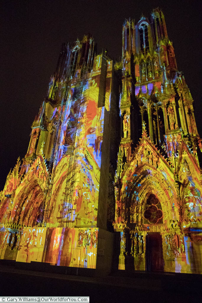 Another scene projected onto Reims Cathedral at night.