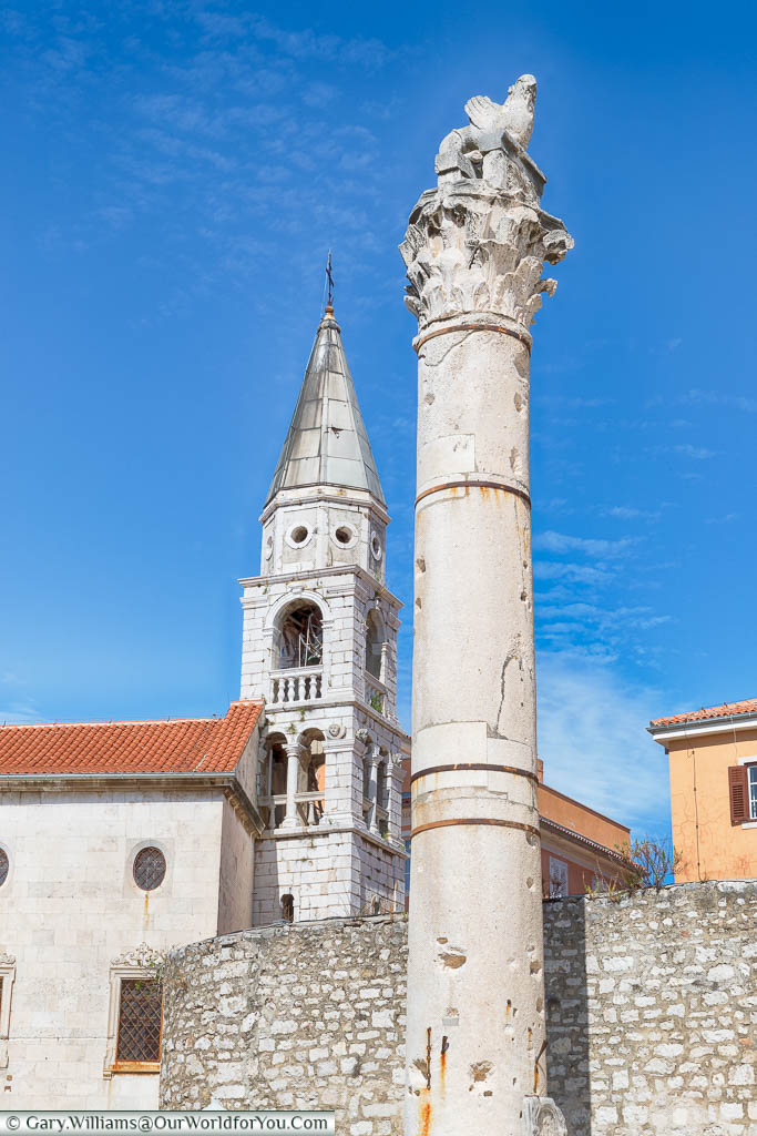 The Roman 'Pillar of Shame' in the Roman Forum of Zadar, with the Venetian Bell Tower in the background
