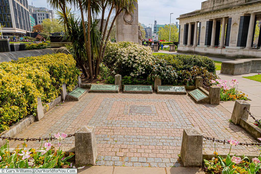 A brick-paved square in Trinity Square and Gardens with a brass plaque in the centre commemorating the site of the Ancient Scaffold.