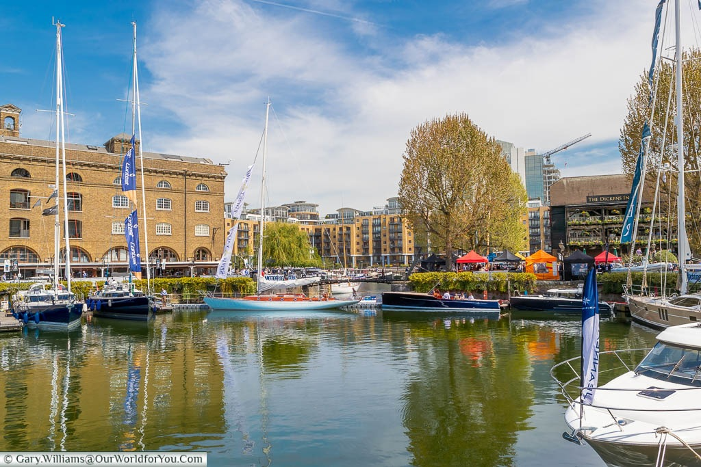 Sailing boats moored in a small marina at St Katharine Docks, a tranquil oasis a stone's throw from Tower Hill underground station.