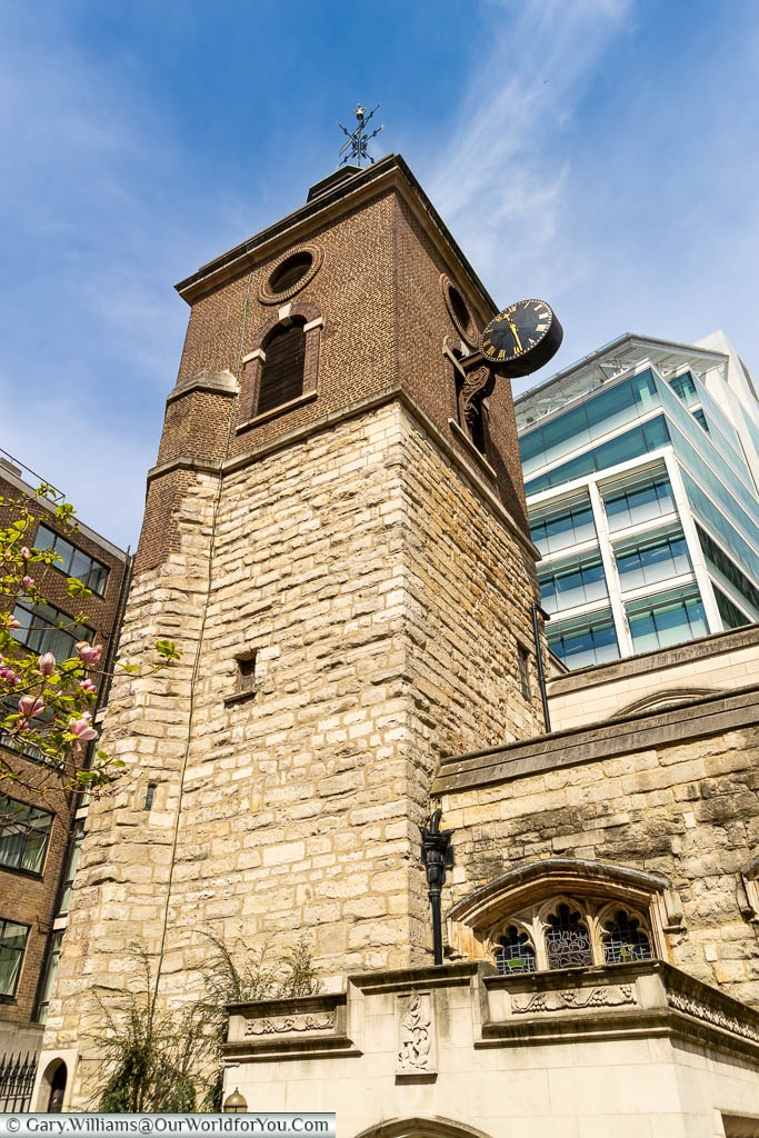 The tower of St Olave's Church in the City of London against the backdrop of the modern skyline.