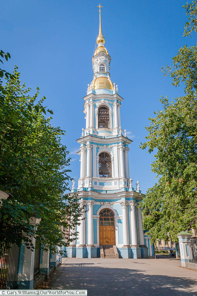 The Bell Tower of St Nicholas Naval Cathedral stands separate to the Cathedral   It is decorated in the same powder blue, with white columns and crowned by a gilded spire.