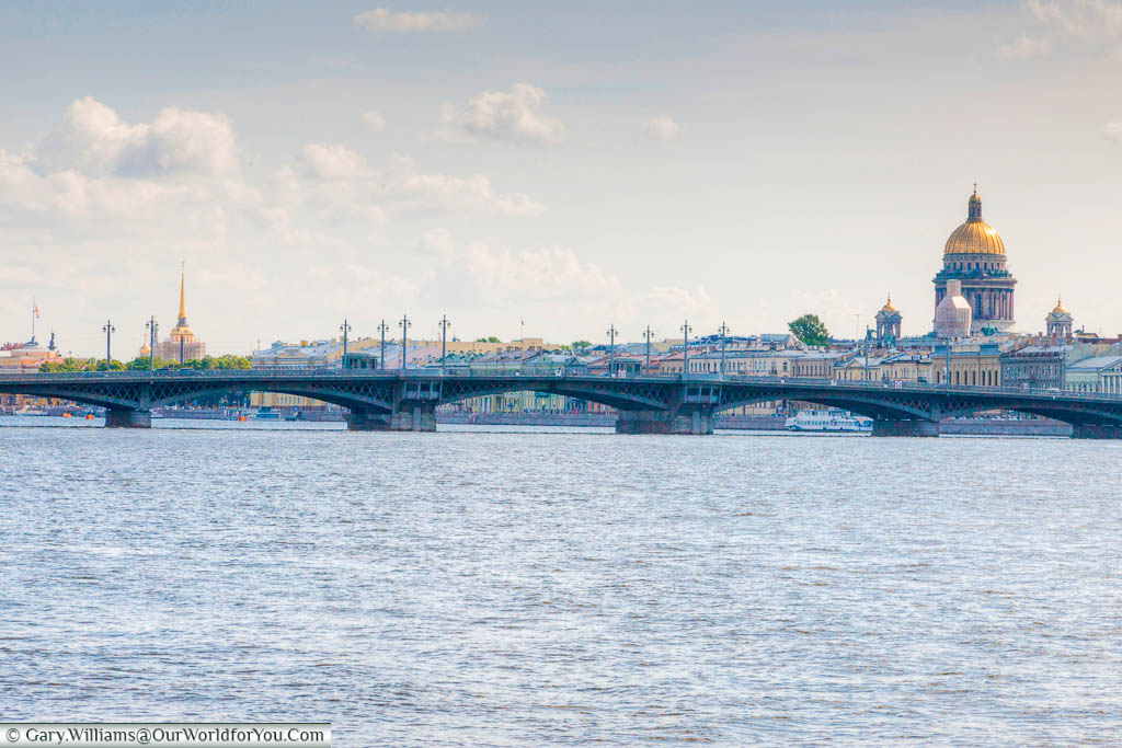 The Blagoveshchensky Bridge over the River Neva with St Isaac's dome visible in the background of Saint Petersburg, Russia