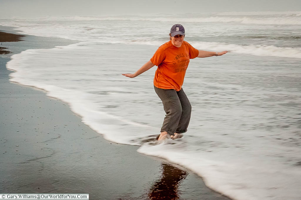 Janis dipping her toes into the Caribbean at Tortuguero, Costa Rica