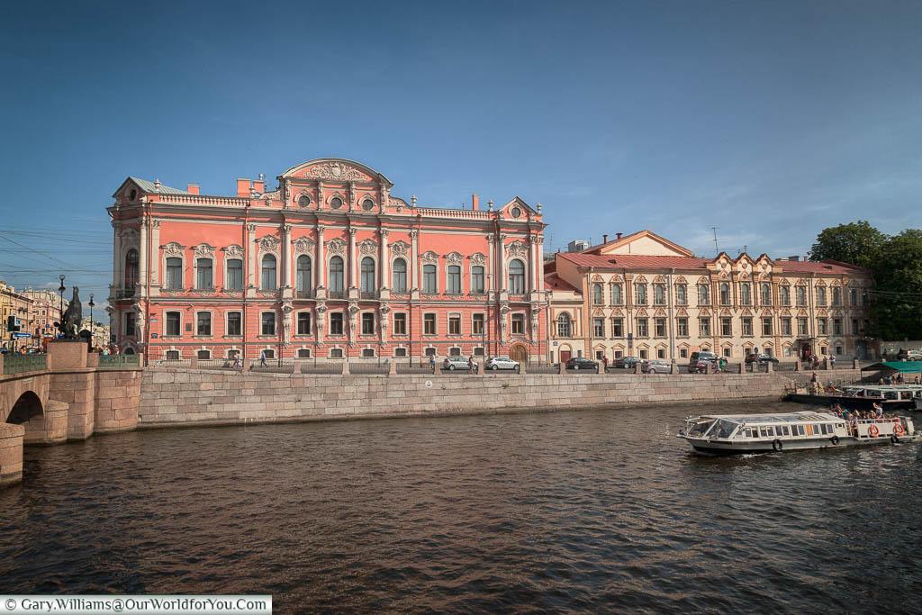 The salmon pink Beloselskiy Palace on the Fontanka River embankment, Saint Petersburg, Russia