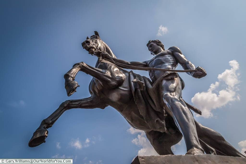 The final Horse Statue on the Anichov Bridge with the trainer standing proud with the animal now under control.