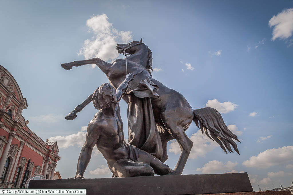 The first Horse Statue on the Anichov Bridge depicting the trainer lying on the ground