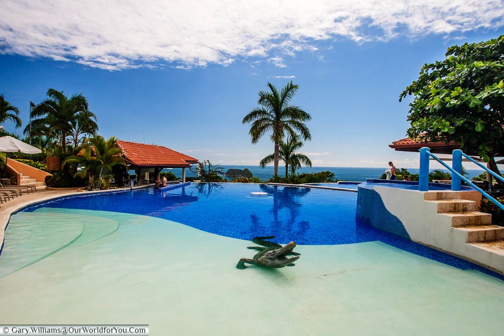 The pool of the Hotel Parador in Manuel Antonio, Costa Rica. A life-size bronze Aligator guards the shallow end.