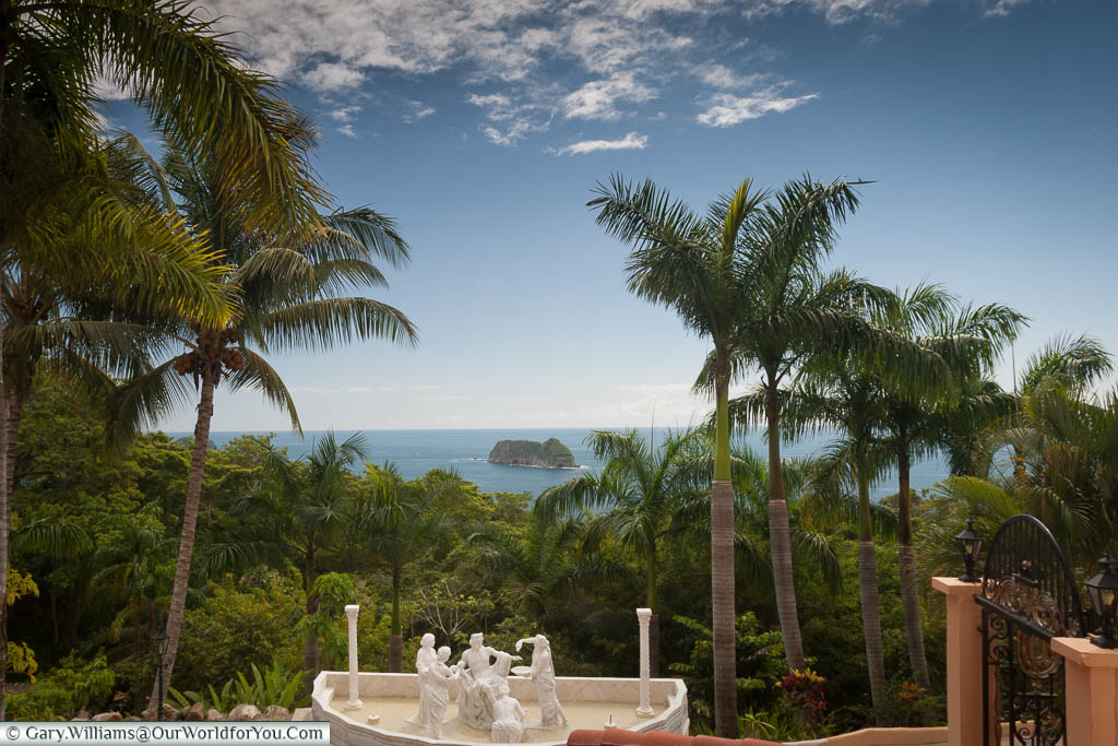 A view of the Pacific Ocean, through palm trees, from the lobby of the Hotel Parador in Manuel Antonio on Costa Rica's western coastline.