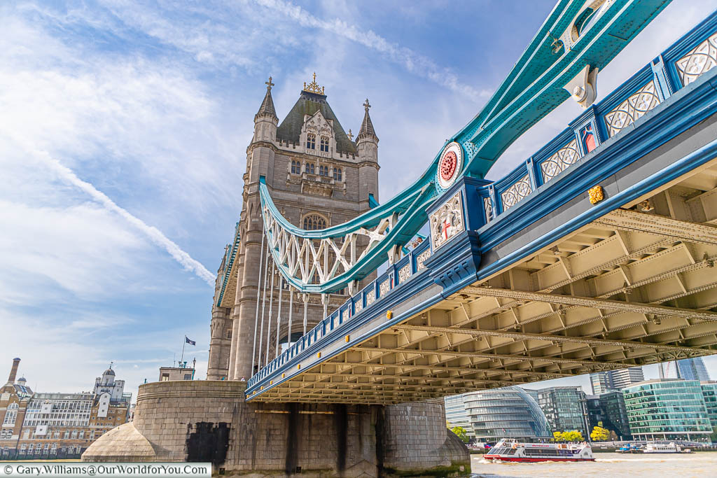 A view of Tower Bridge from the Riverside walk on the north bank of the Thames.  Here you can see close-up detail of the ironwork leading up to the north tower of the bridge.