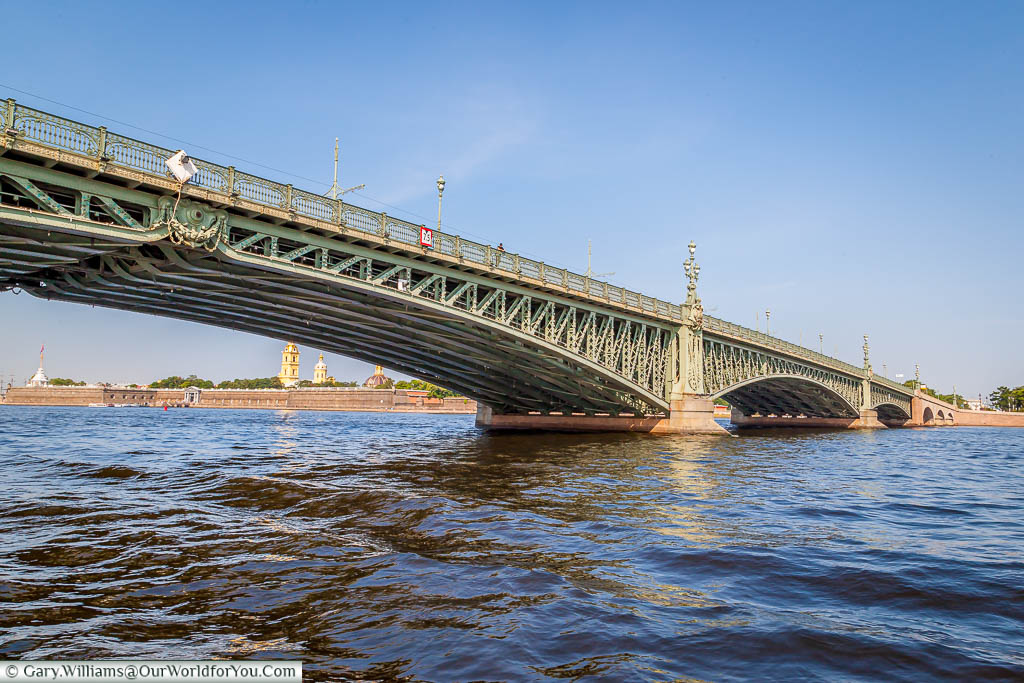 Floating under the centre span of the green, cast-iron, Trinity Bridge over the Neva River, Saint Petersburg, Russia.